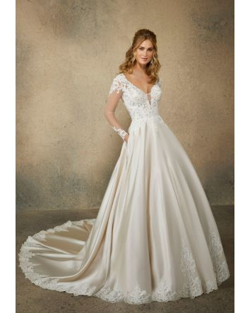 Long Sleeves Reina Wedding Dress Style 2082 features Pearl & Crystal Beaded, Alençon Lace Appliqués on  A-Line, Ball Gown with Sweetheart V-Neckline & Illusion back