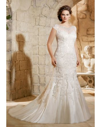 High neckline with crystal embroidery and lace covered back with buttons. Fit and flare style with small train.