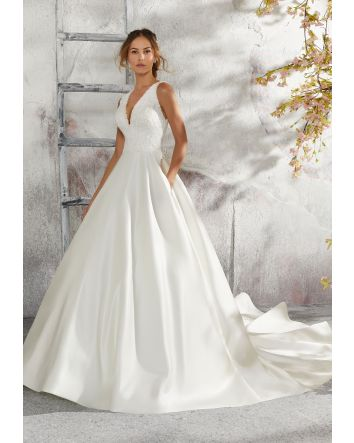 Morilee's Laurie Satin Ballgown Wedding Dress Sleeveless w/Appliquès, Lace, & Beading This elegant sleeveless Laurie designer bridal gown features beautiful appliquès, lace, and beading on an intricately designed satin wedding dress. Available in white a