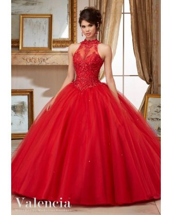 Halter top bodice with lace bodice with sequince beads. Large tulle ball gown skirt with small train. Embroidery and Beading on Tulle Ball Gown Quinceañera Dress. Matching Stole Included.