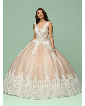 This elegant one-piece ball gown features a beautiful two-toned effect of creamy floral lace over delicate lace patterned tulle. Designed with lace applique over sheer illusion,the bodice has the look of a V-neck in front but with a modest sheer bateau ne
