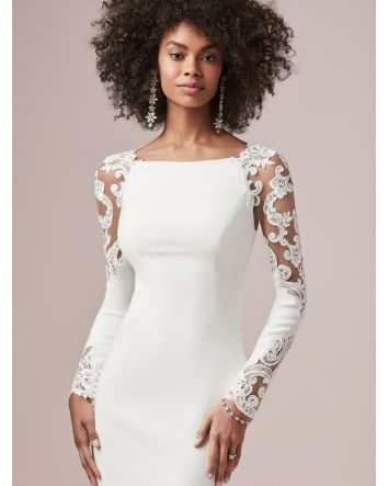 For when there's no need to complicate a timelessly romantic bridal look, opt for crepe, illusion lace, and not much more. This long sleeve sheath wedding dress is our latest crush.