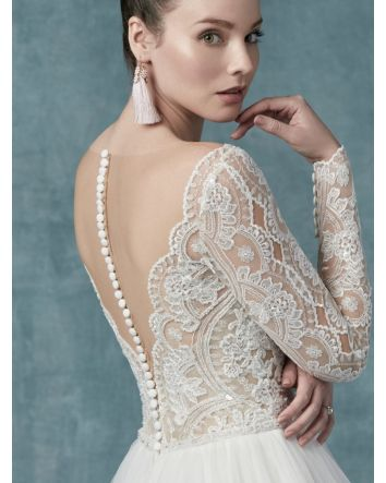 Sexy, romantic, and utterly feminine, this long-sleeve ball gown wedding dress is a transformative thing to behold.