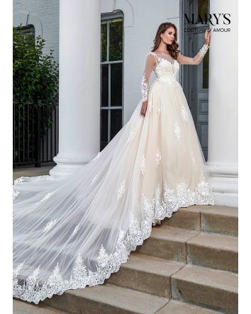 This Marys Bridal Couture D Amour MB4044 A-line bridal gown features a lace-appliqued top with a sheer neckline, illusion long sleeves and buttoned sheer back. Matching appliques embellish the tulle ballgown skirt, creating a scalloped hem. Set includes a
