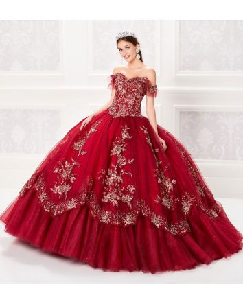 Off the shoulder sparkle tulle and appliques ball gown featuring a ruffled sleeve, sweetheart neckline, basque waist, corset back, tiered skirt with embroidered trim, a small train and stone accents throughout. Featuring a tulle cape.  Magical Details:
