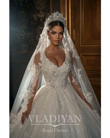RL2202 – A gorgeous ball gown with a unique design. The bodice is decorated with 3D appliqués and beads. The skirt is sewed of sparkling fabric. Lush train complements the look. The mission of Vladiyan Royal brand is to remind every woman that she deserv