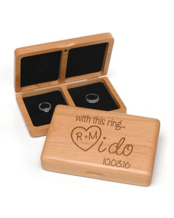 """This wooden """"With this ring...I do"""" box is a unique and romantic way to present your rings at the ceremony. The box is engraved with your custom personalization.  Product Details Dimensions: 7"""" x 4 1/2"""" x 1 1/2"""" Type of Printing: Engraved Price Inclu"""